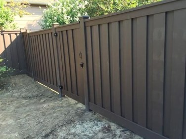 Gorgeous Black Wooden Fence Design Ideas For Frontyards 30