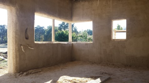 View of the kitchen with the second coat of render