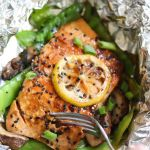 "Pinterest graphic with the words ""Whole30, Keto Foil Wrapped Salmon with snow peas and mushrooms"" with a photo of the finished dish."