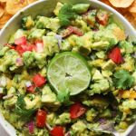 "The finished dish with the text ""Whole30, Vegan, Gluten Free Mango Guacamole"" for Pinterest."