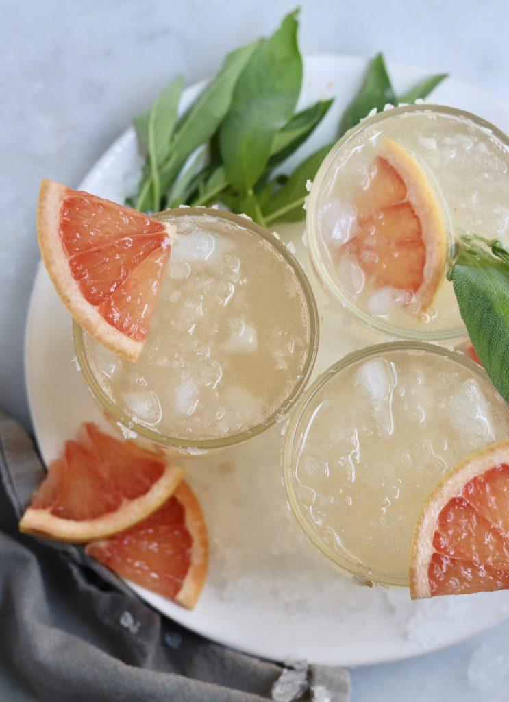Grapefruit Sage Sparkler Mocktail in glasses garnished with grapefruit slices - Finished