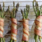 "Whole30 Finished dish with the text ""Bacon Wrapped Asparagus"" for Pinterest"