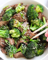 Whole30 Beef and Broccoli Stir Fry, an easy Paleo weeknight dinner made with Flank Steak. I top it with sesame seeds and sliced green onions. Gluten Free!