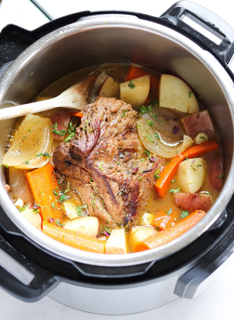 Top down of the roast and vegetables in the Instant Pot.