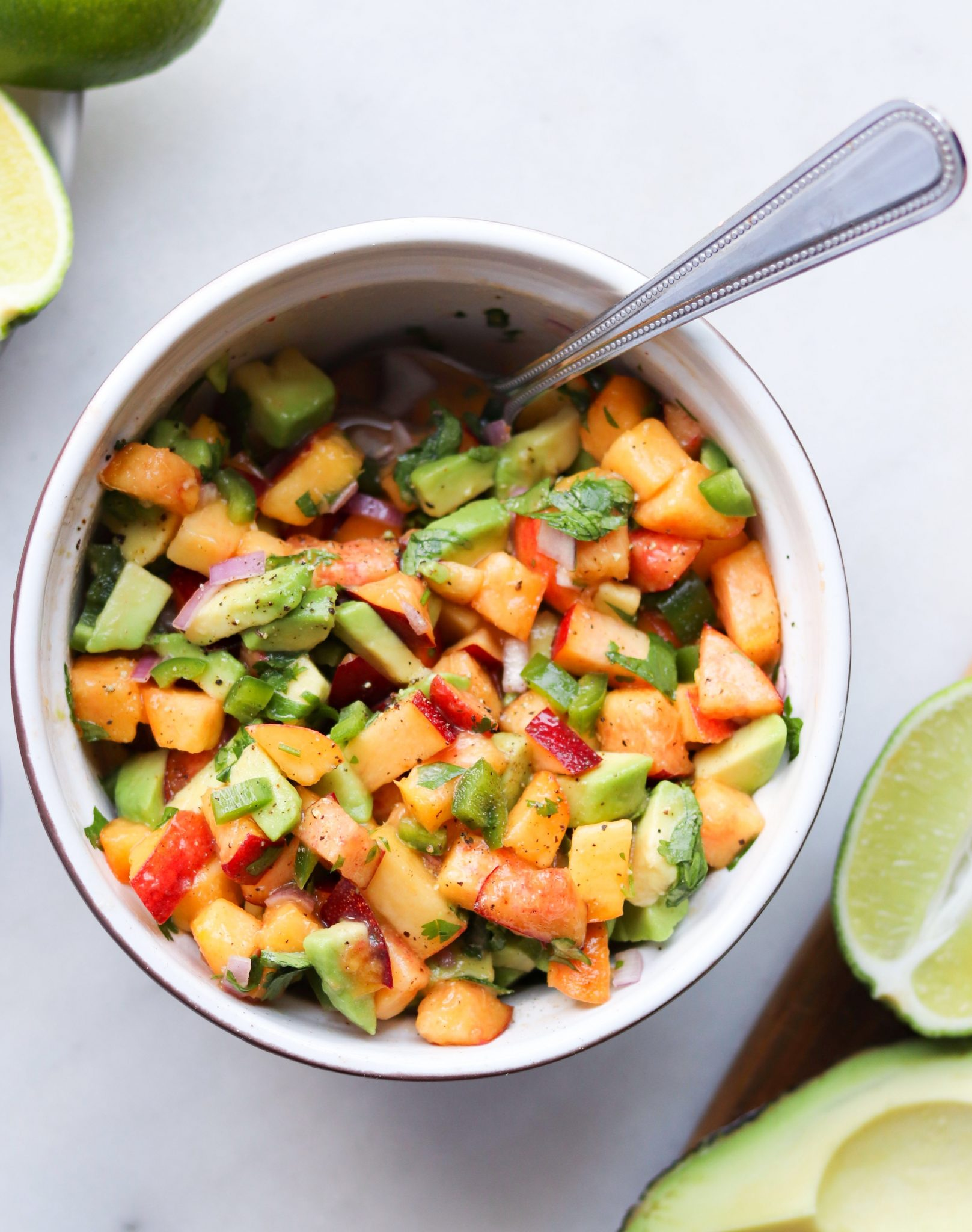 Peach Avocado Salsa - Finished Dish in a bowl with a spoon