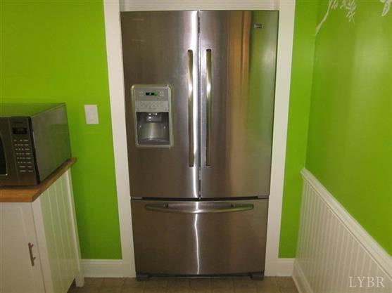 A photo of the fridge inserted in the wall.
