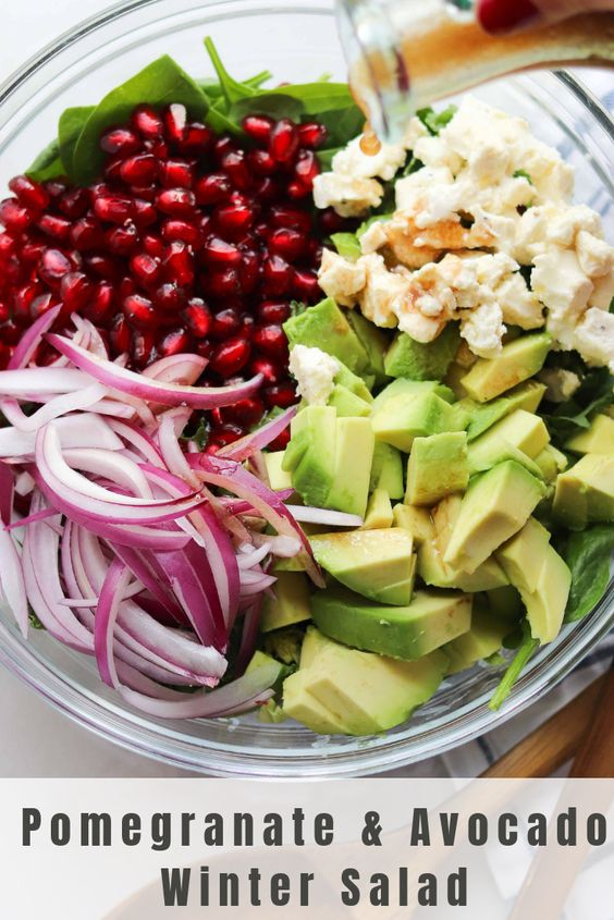 """Pinterest graphic with the finished dish and text """"Pomegranate and Avocado Winter Salad"""""""