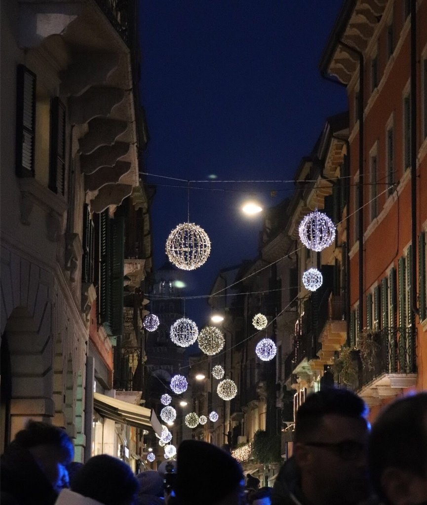 Verona, Italy City Streets lit up with Christmas lights.