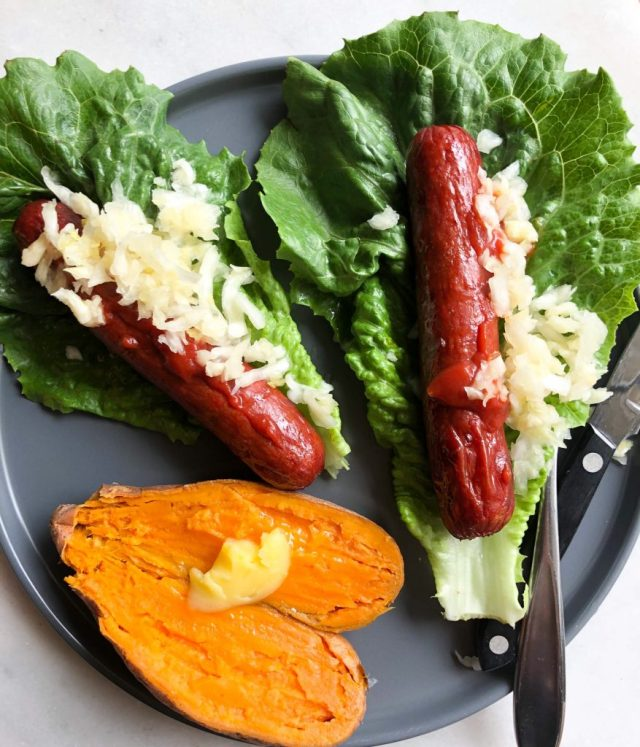 Hot Dog Lettuce Wraps & Microwaved Sweet Potatoes, a quick and easy Whole30 dinners, on a blue plate.