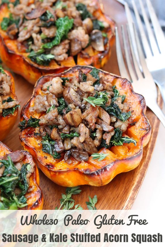 """Pinterest Image with finished dish and the text """"Whole30, Paleo, Gluten Free Sausage and Kale Stuffed Acorn Squash."""""""
