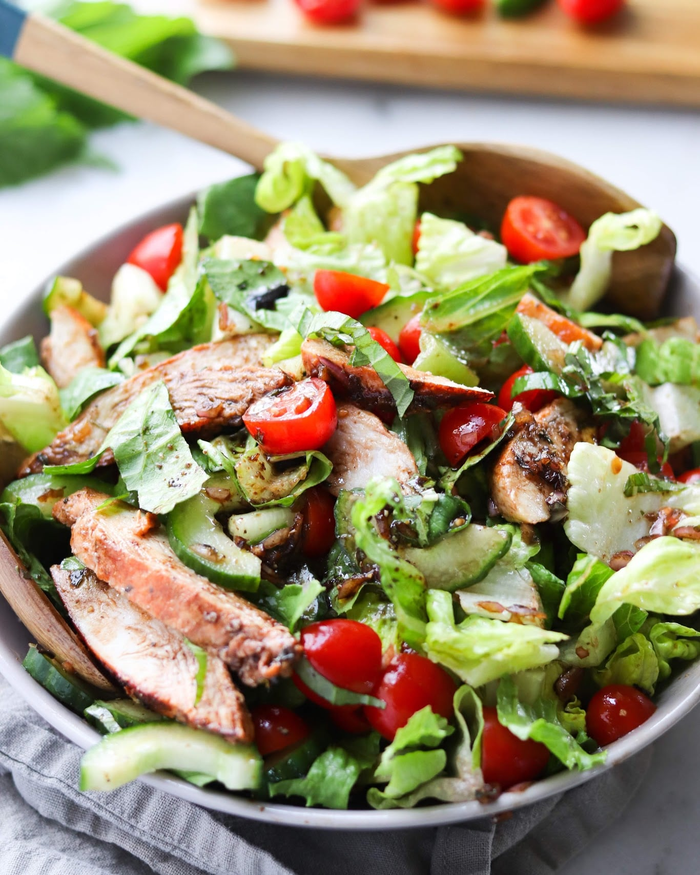The salad is dressed with the balsamic shallot vinaigrette and all the ingredients are tossed together.