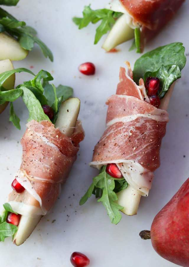 Close up of two Whole30 Prosciutto Wrapped Pears slices, finished dish.