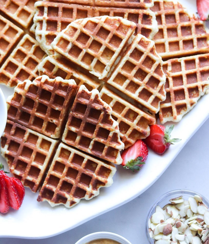 Close up of the cooked paleo waffles on a white serving tray.