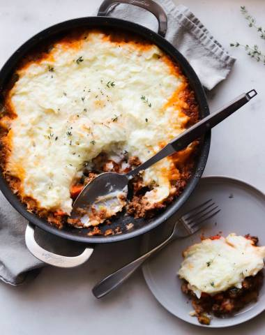 Shepherd's Pie on a white platter with a serving spoon.