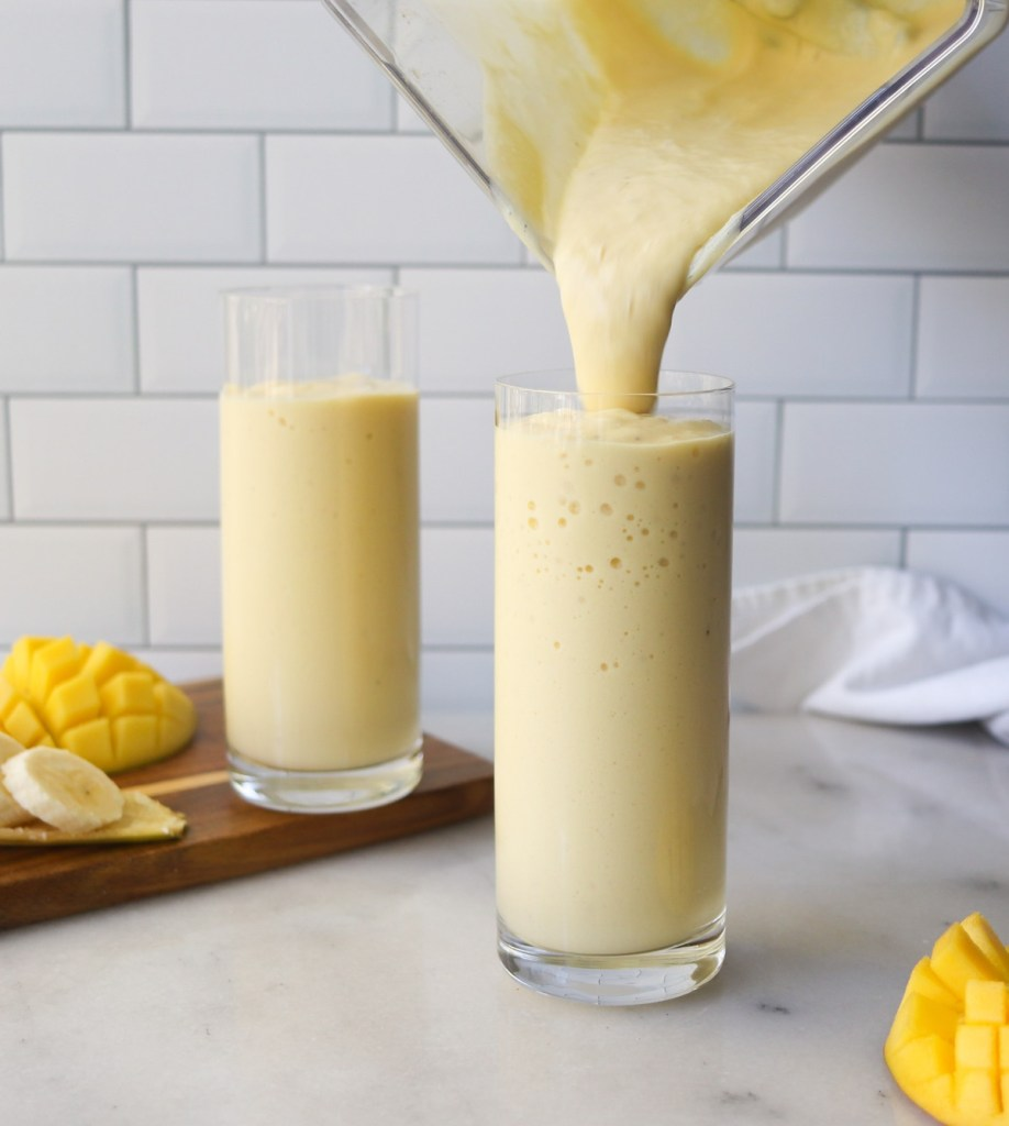 Side view of the blended smoothie being poured into a glass.