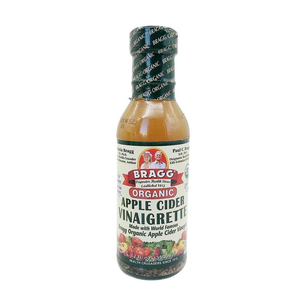 Close up a jar of Bragg's organic apple cider vinaigrette.