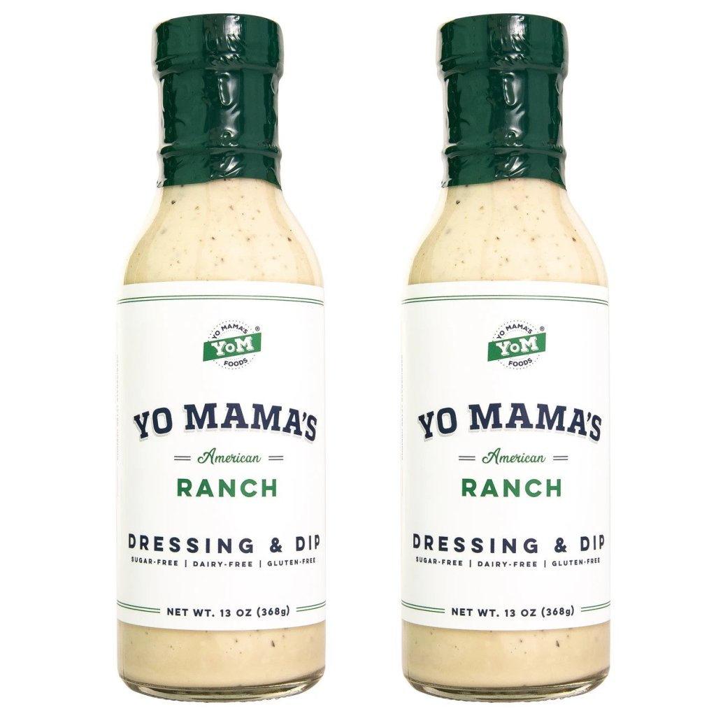 Two glass bottles of Yo Mama's ranch with white labels.