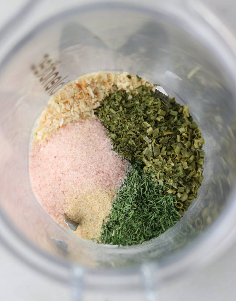 Close up of the recipe ingredients added to a blender cup.