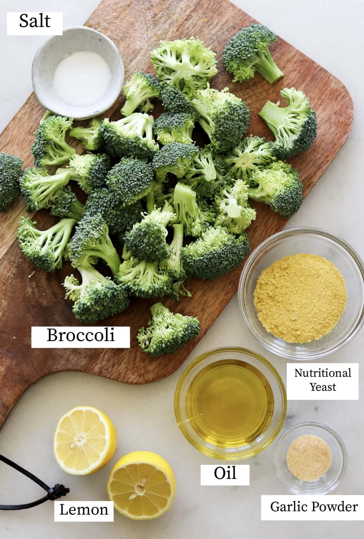 The recipe ingredients separated and labeled: Broccoli, nutritional yeast, salt, lemon, oil, garlic powder.