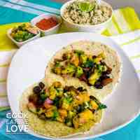 Black bean mango tacos ready to eat and served with coconut brown rice.