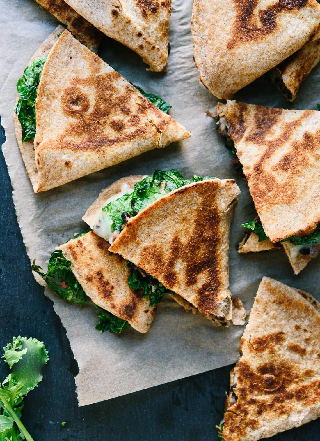 Crispy quesadillas stuffed with broccoli rabe and black beans! cookieandkate.com