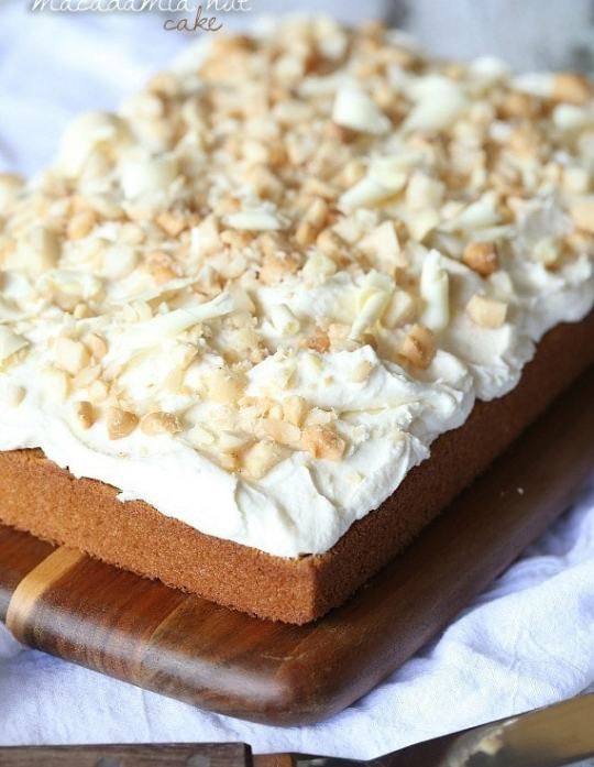 White Chocolate Macadamia Nut Cake.. A simple brown sugar buttermilk cake with white chocolate frosting, topped with salty Macadamia Nuts!
