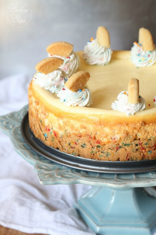 Sugar Cookie Cheesecake...a simple cheesecake with a sprinkle sugar cookie base! Classic at it's best!