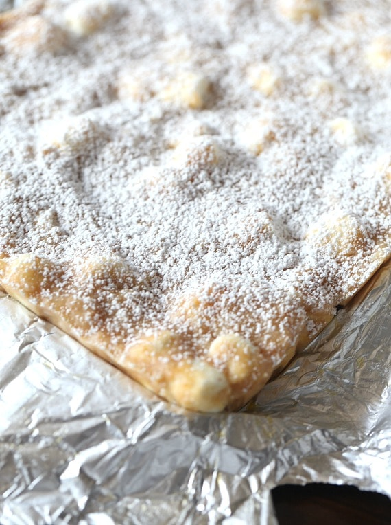 "These NO Bake ""Snow Drift Bars"" are a delicious combination of a custard base mixed with crushed Nilla Wafers, coconut and marshmallows! They are so pretty, buttery and sweet!"