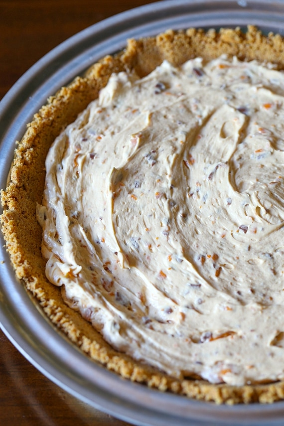 Making Butterfinger Pie in a graham cracker crust!