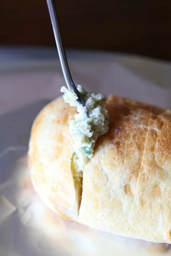 Stuffing my Garlic Bread with buttery goodness!