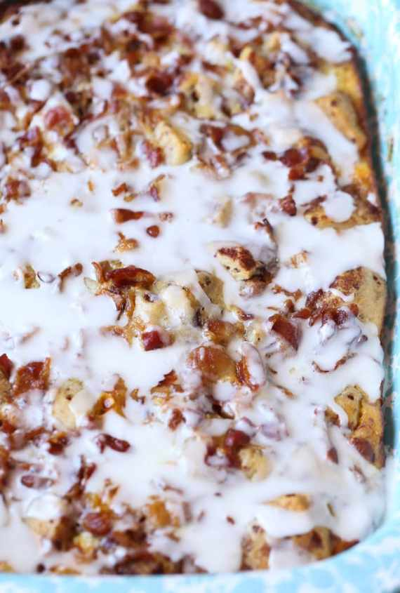 Cinnamon Roll Breakfast Bake...this is sweet and salty perfection. Crispy bacon and soft cinnamon rolls baked together and topped with icing!