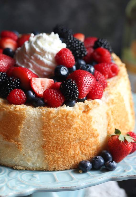 Soft and light Angel Food Cake topped with Wine Soaked Berries! So easy and elegant!