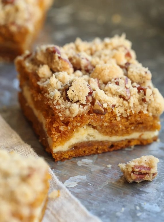 Cream Cheese Swirled Pumpkin Praline Bars, soft and packed with fall flavor!