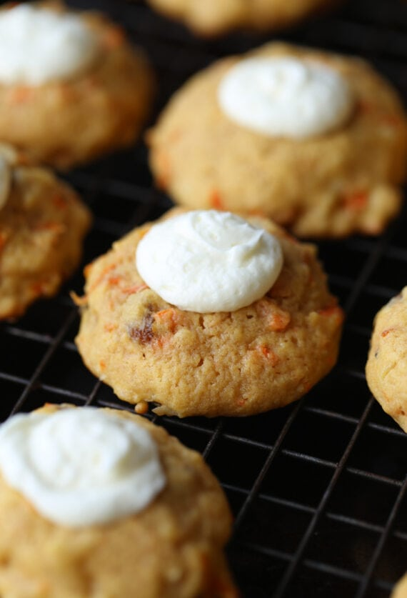 Carrot Cake Thumbprint Cookies on a plate with cream cheese frosting