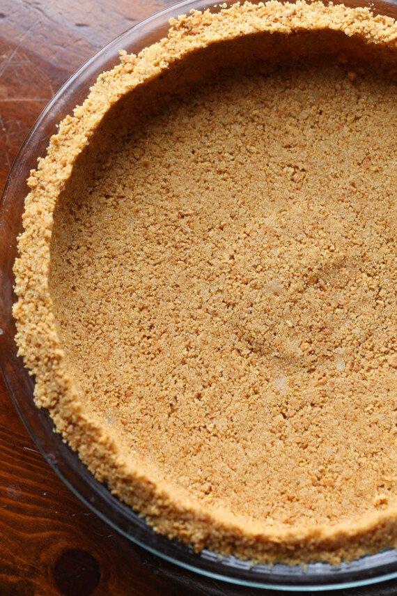 Graham cracker pie crust in a pie pan.