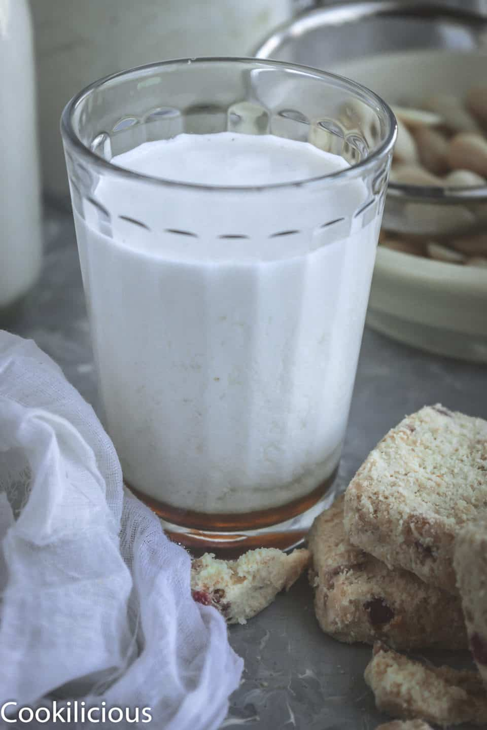 close up shot of a glass full of Almond Milk