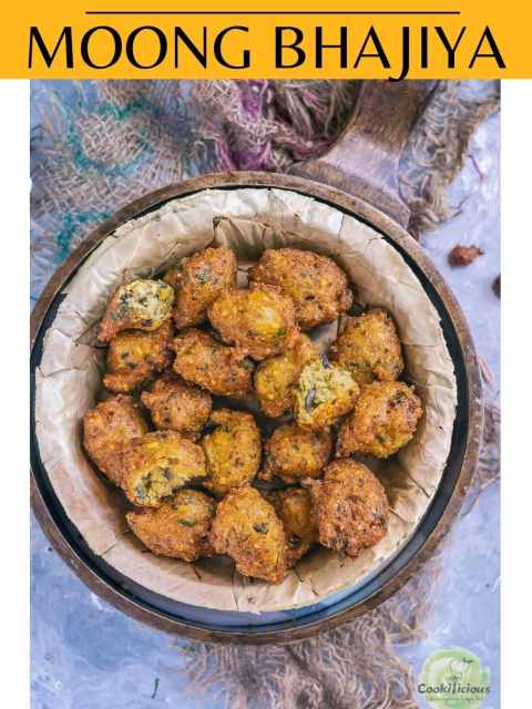 Crispy Moong Dal Pakora served n a round bowl with green chutney on the side and text at the top