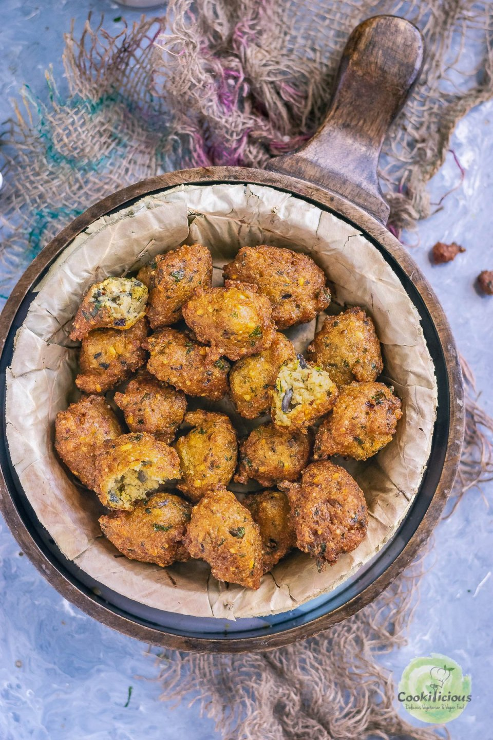 a bowl filled with Crispy Moong Dal Pakora (one of the popular easy vegan appetizers)