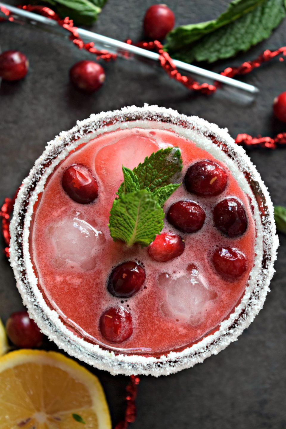 Amortentia in a glass with floating cherries on top