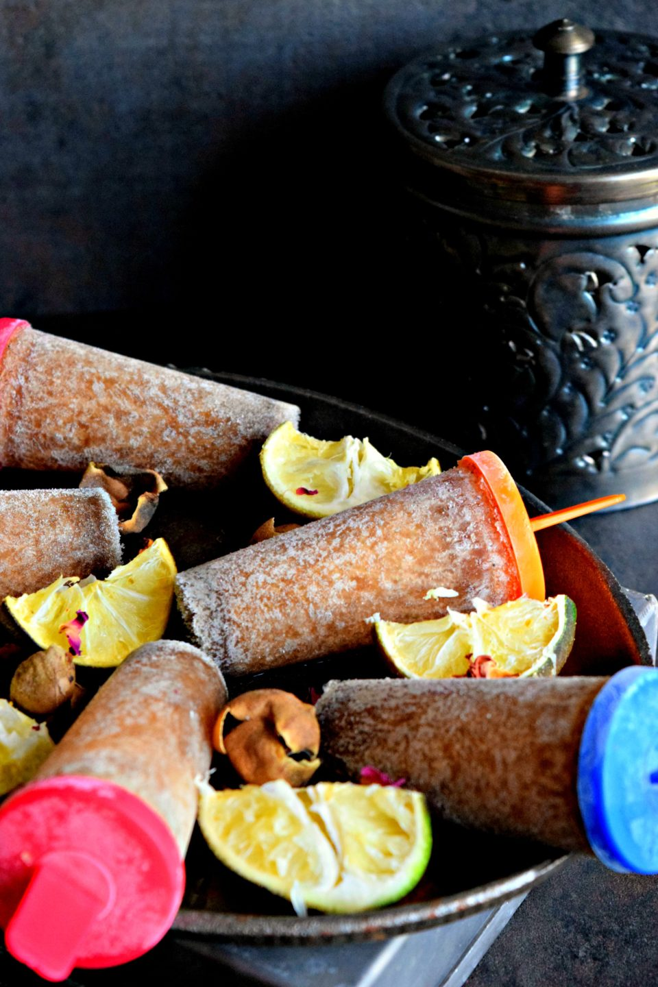 Masala Soda Popsicle is a quick fix ice pop recipe using coca cola & some Indian spices. When you have nothing at hand, make this yummy Popsicle & cool off!