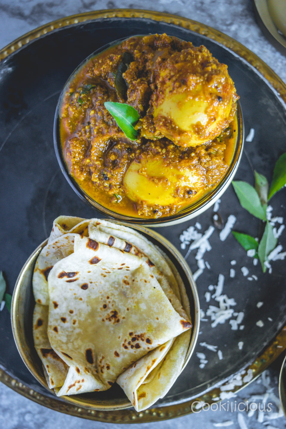 top shot of Spicy Chettinad Style Egg Roast Curry served with roti