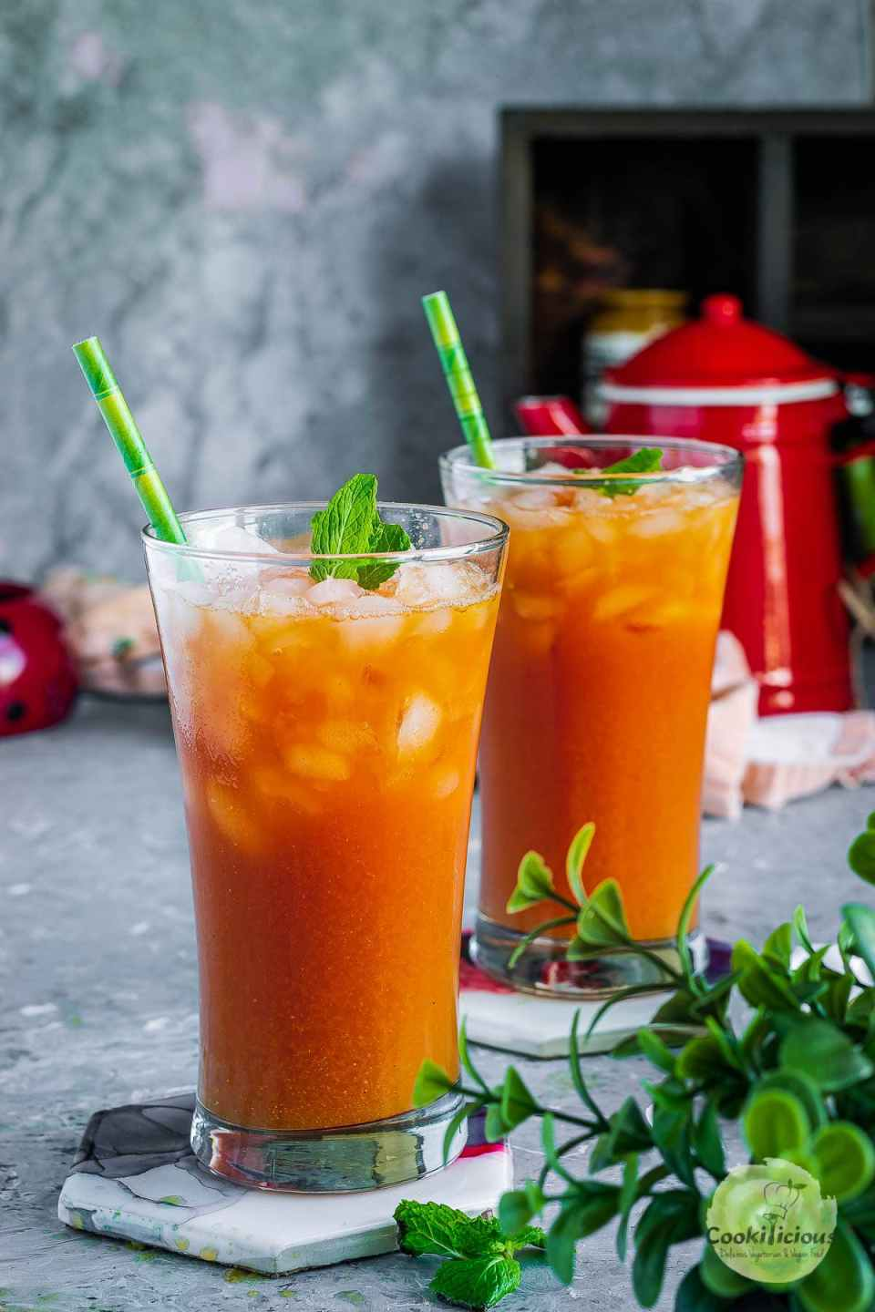 2 glasses filled with watermelon juice recipe - Sugar Free Drink with straws in it