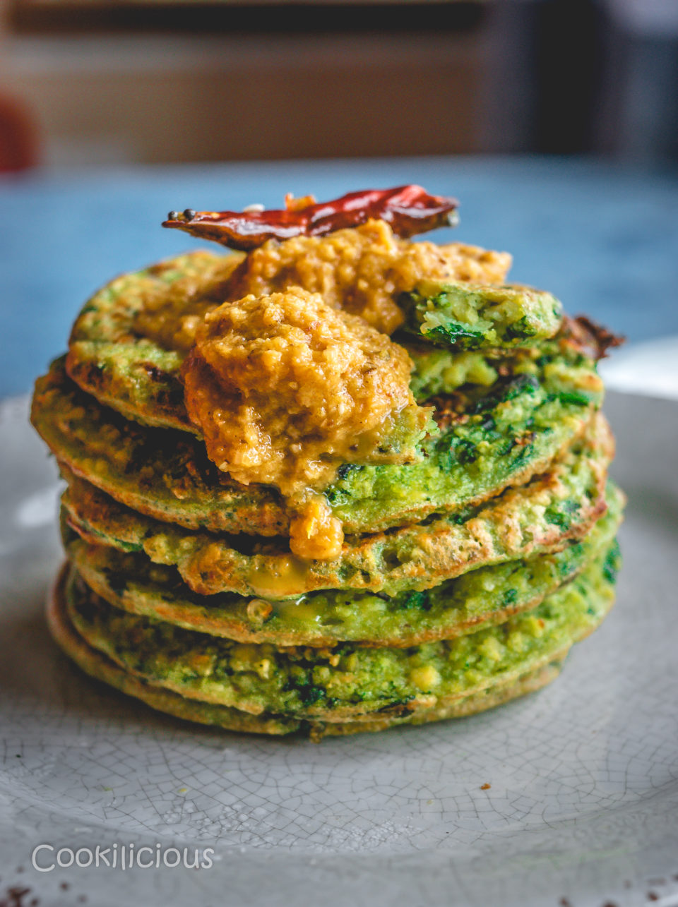 Kale Adai stacked one on top of the other with chutney on top