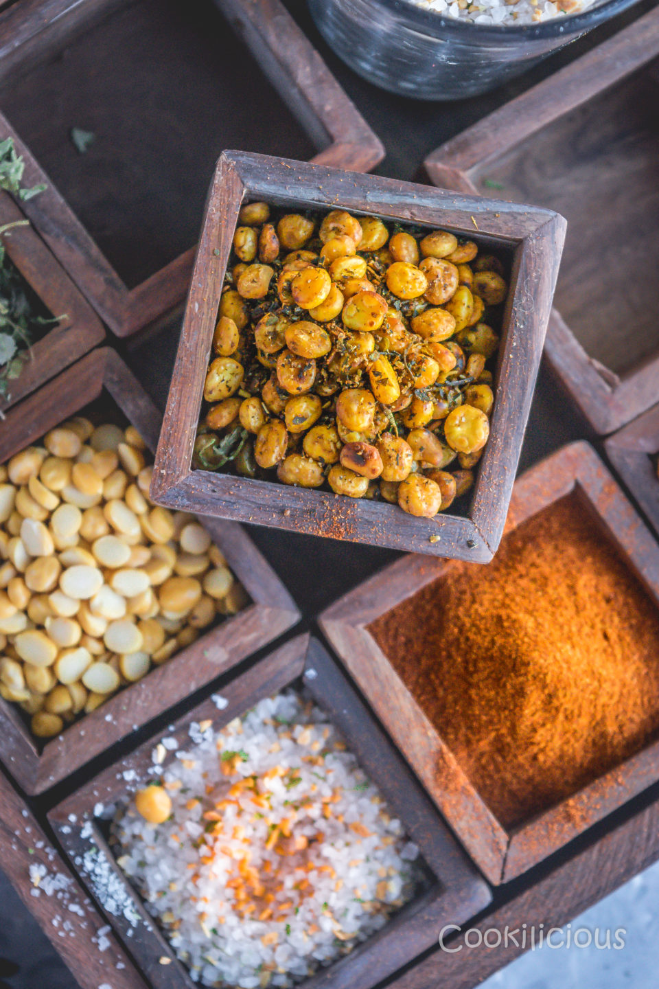 a box filled with Crispy Vegan Split Peas resting over a masala dabba