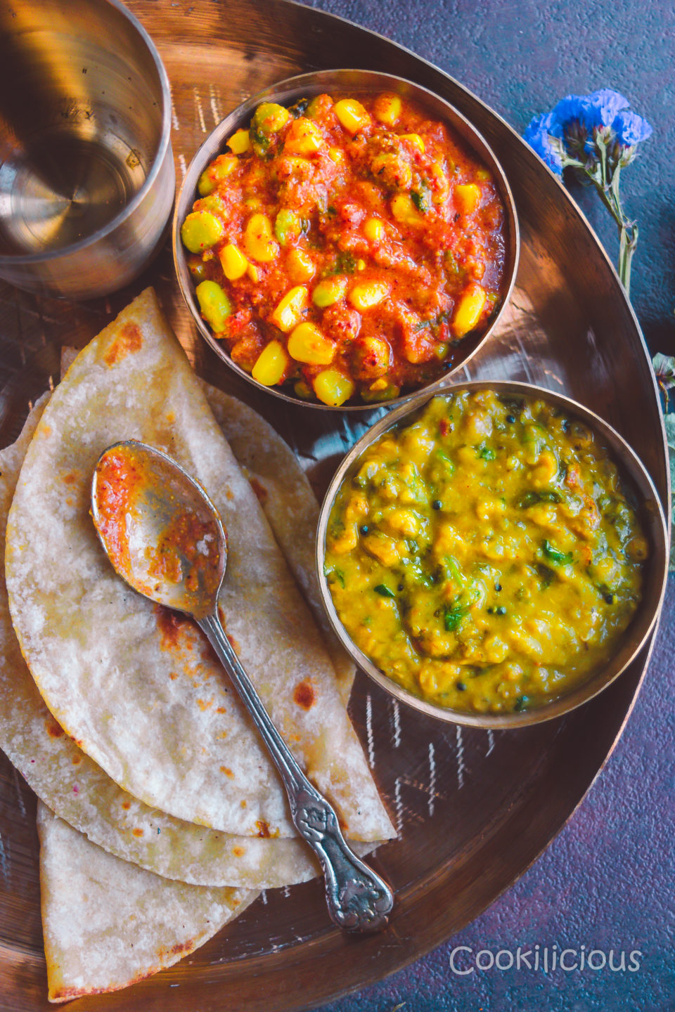top angle shot of a thali with a bowl of Edamame & Sweet Corn Gravy, Indian dal and chapati