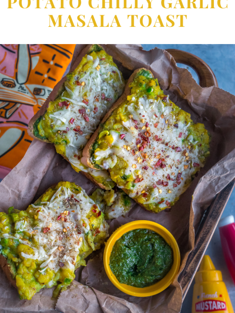 Potato Chilly Garlic Masala Toast served in a tray over crumbled paper with a bowl of green chutney on the side and text on top