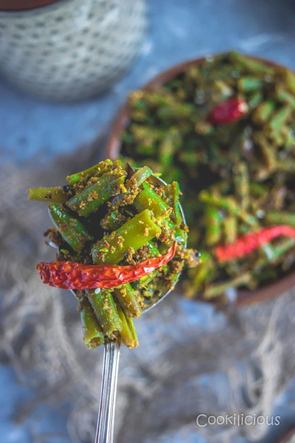 close up shot of a spoonful of Sesame Flavored Green Beans Stir Fry