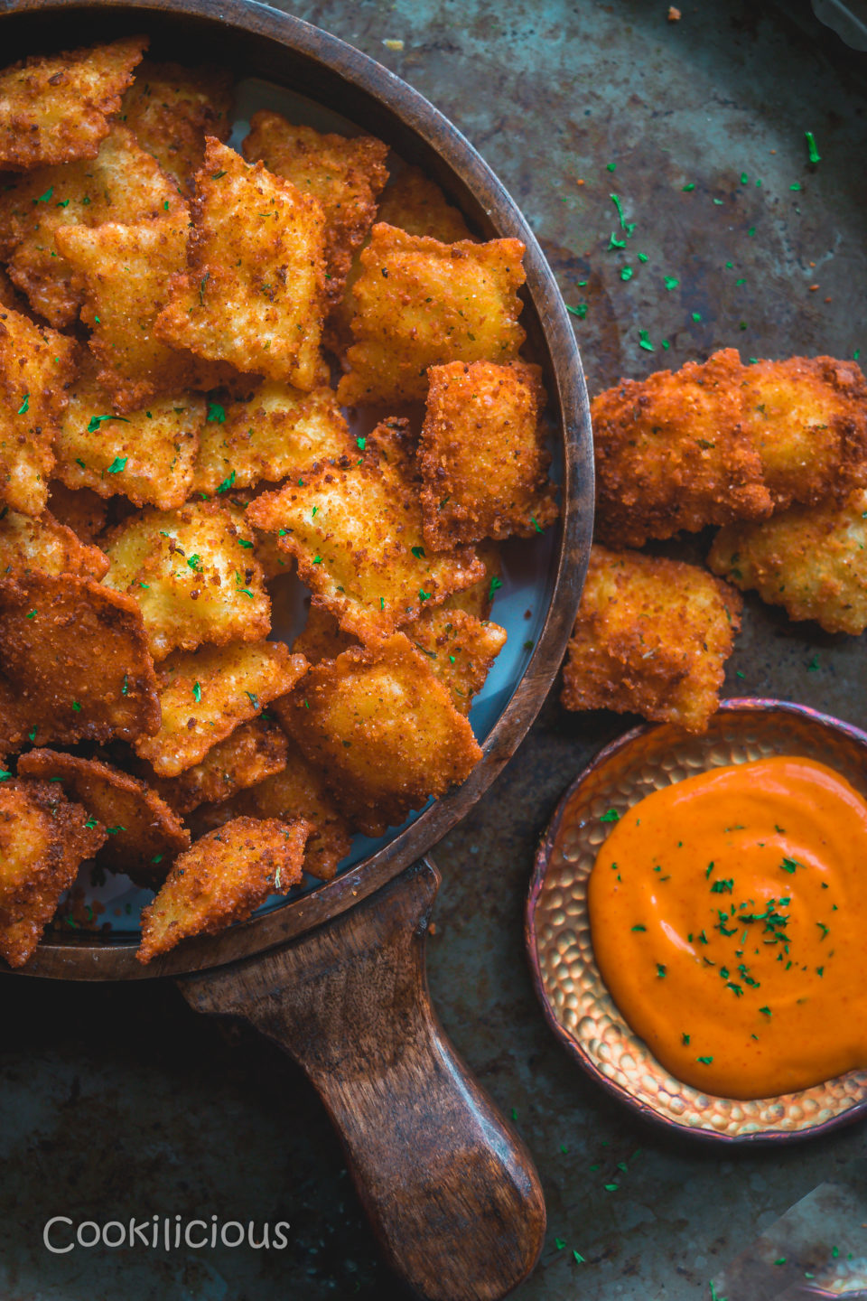image of half a tray filled with Copycat Olive Garden Cheesy Fried Ravioli