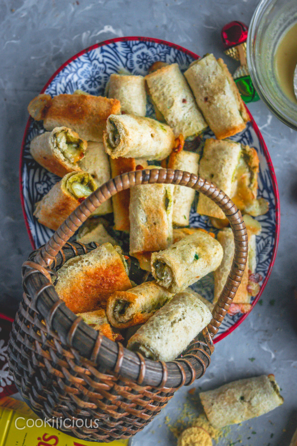 a basket filled with Baked Bread & Chutney Rolls fallen over a plate