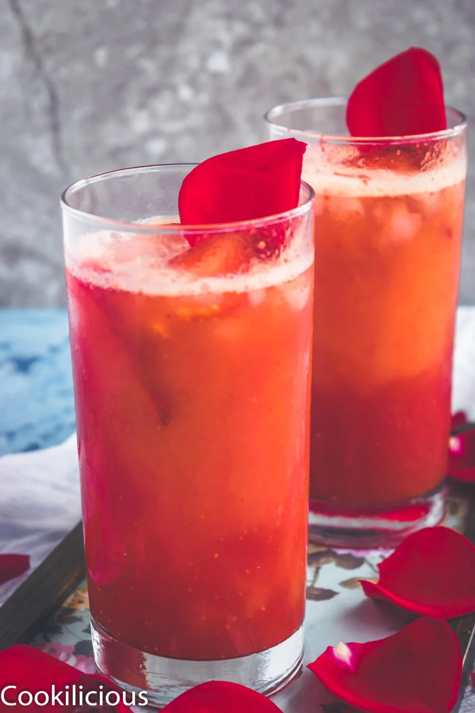 front angle shot of 2 tall glasses filled with Tropical Orange Strawberry Spritzer